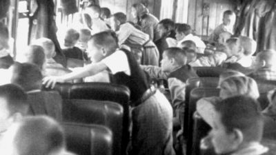 On the way to their new home. Polish children look out the railcar windows to see New Zealand children welcoming them, pictures provided by the Polish Children's Reunion Committee