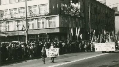 "Elżbieta with her son, Wojtek, in the first row during the Labour Day parade. Her sign says: "" I want work, not unemployment benefits!"", 1st May 1986, from the private archive"